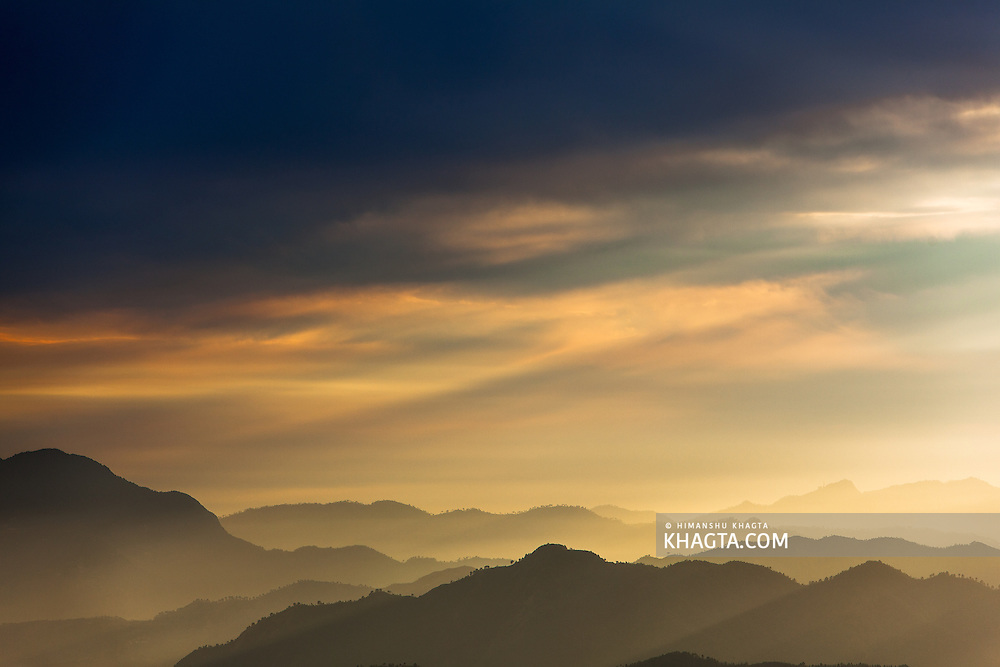Evening landscape of the Himalayan mountain range during the sunset in the outskirts of Shimla, Himachal Pradesh, India