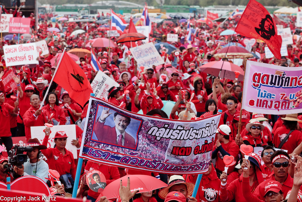 "Mar. 26, 2009 -- BANGKOK, THAILAND: More than 30,000 members of the United Front of Democracy Against Dictatorship (UDD), also known as the ""Red Shirts""  and their supporters descended on central Bangkok Thursday to protest against and demand the resignation of current Thai Prime Minister Abhisit Vejjajiva and his government. Abhisit was not at Government House Thursday. The protest is a continuation of protests the Red Shirts have been holding across Thailand in March.  Photo by Jack Kurtz"
