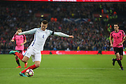 England Midfielder Eric Dier crosses the ball during the FIFA World Cup Qualifier group stage match between England and Scotland at Wembley Stadium, London, England on 11 November 2016. Photo by Phil Duncan.