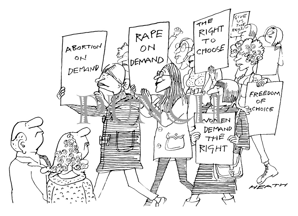 (Feminists on a pro-abortion rally. One of the marchers carries a placard saying 'Rape on Demand')