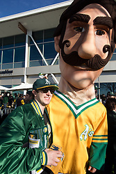James Vernon of Napa, Calif. poses with mascot Rollie Fingers during the Oakland Athletics FanFest at Jack London Square on Saturday, Jan. 27, 2018 in Oakland, Calif. (D. Ross Cameron/SF Chronicle)