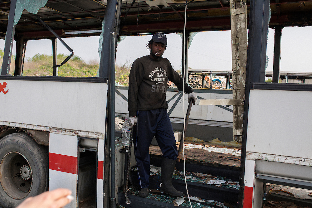 One of Dinko Valev's employees at his junkyard for busses, Jamal is from the Ivory Coast and had immigrated to Bulgaria the year before.<br /> <br /> Matt Lutton / Boreal Collective for VICE