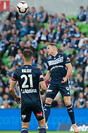 Melbourne Victory midfielder Leigh Broxham (6) headers the ball at the Hyundai A-League Round 4 soccer match between Melbourne Victory and Central Coast Mariners at AAMI Park in Melbourne.