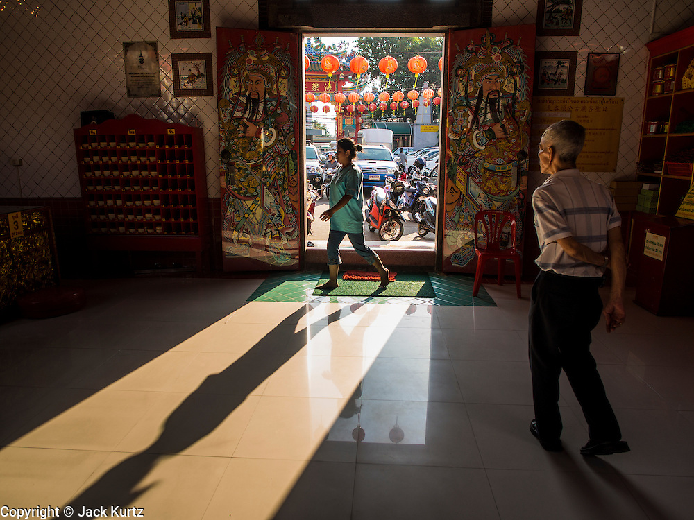 10 JANUARY 2014 - BANGKOK, THAILAND:  People go in and out of Peiing Shrine in the Chinatown neighborhood of Bangkok.       PHOTO BY JACK KURTZ