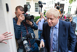 © Licensed to London News Pictures. 12/06/2019. London, UK. A hand clears a path for Boris Johnson MP, who is running to be Leader of the Conservative Party and the next Prime Minister, as he arrives at the official launch event for his leadership campaign. Photo credit: Rob Pinney/LNP