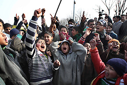 Local residents shout slogans as they block a road during a protest against unscheduled power cuts on the outskirts of Srinagar, summer capital of Indian-controlled Kashmir, Jan. 8, 2013. Locals said that only three hours of power supply was provided daily for the past several weeks, which led to the worsening of the living condition in the cold weather, January 8, 2013. Photo by Imago / i-Images...UK ONLY
