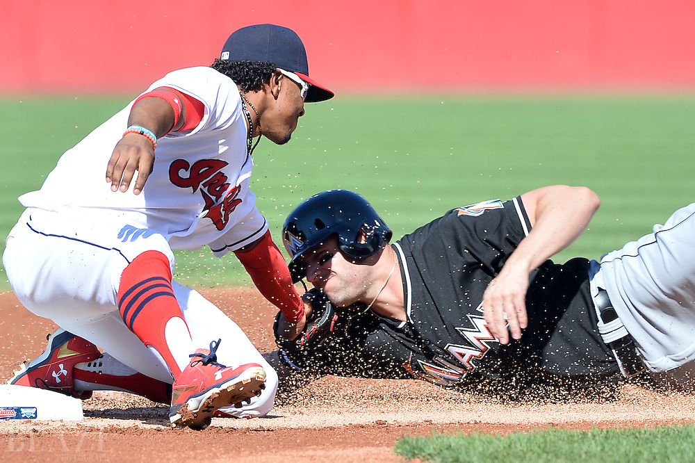 Sep 4, 2016; Cleveland, OH, USA; Cleveland Indians shortstop Francisco Lindor (12) tags out Miami Marlins left fielder Jeff Francoeur (5) trying to steal during the first inning at Progressive Field. Mandatory Credit: Ken Blaze-USA TODAY Sports