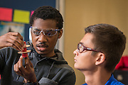 """Members of the Madison High School rocket club team, """"Sensation Station,"""" work on a new rocket, April 15, 2016. The team qualified to compete in the national finals of the Team America Rocketry Challenge (TARC), which will be held outside of Washington, D.C. on the weekend of May 13-15, 2016.<br /> <br /> TARC is the world's largest student rocket contest and a key piece of the aerospace and defense industry's strategy to build a stronger U.S. workforce in science, technology, engineering, and mathematics (STEM). It gives students the opportunity to apply their math and science skills to a real-world project outside the classroom. This year's qualifying challenge was to design, build, and fly a rocket that has a maximum altitude of 850 feet, returns to the ground within 45 seconds, and carries two eggs, which have to survive the flight unscathed. 789 teams from all 50 states entered this year's contest. The Madison High school team, as the only team within the Houston Independent School District, emerged from the qualifying round as one of the 100 best teams that will go on to compete for more than $100,000 in scholarships and the title of National Champion.<br /> <br /> The members of the Madison High School team, mentored by AP Physics teacher Dr. Maqsuda Afroz, are Dennis Ngyuen, Cristhian Benavides, Justin King, Kelon Tidwell, and Cristian Ramirez."""