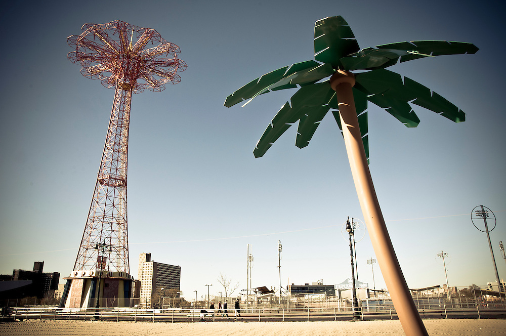 The Coney Island Parachute Jump Tower with a palm tree on the beach, Brooklyn, New York, 2010.