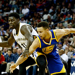 Dec 13, 2016; New Orleans, LA, USA;  New Orleans Pelicans guard Jrue Holiday (11) is defended by Golden State Warriors guard Stephen Curry (30) during the second half of a game at the Smoothie King Center. The Warriors defeated the Pelicans 113-109. Mandatory Credit: Derick E. Hingle-USA TODAY Sports