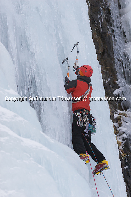 Skarphéðinn Halldórsson climbing ice at Kaldakinn sea cliffs.