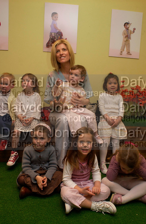 Lucy Sykes and children. Launch of 'Lucy  Sykes Baby, New York' Selfridges. 14 April 2005. ONE TIME USE ONLY - DO NOT ARCHIVE  © Copyright Photograph by Dafydd Jones 66 Stockwell Park Rd. London SW9 0DA Tel 020 7733 0108 www.dafjones.com