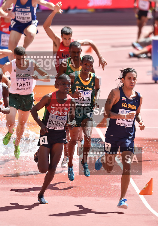 BEIJING, CHINA - AUGUST 22: Dikotsi Lekopa (South Africa) as Jairus Kipchoge Birech (Kenya) and Gerald Giraldo (Colombia) lead the race in Round 1 of the mens 3000m steeplechase  during day 1 of the 2015 IAAF World Championships at National Stadium on August 22, 2015 in Beijing, China. (Photo by Roger Sedres/Gallo Images)