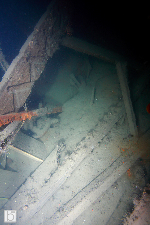 Powerfull strobes light up only a small portion of the stern area on the wreck of the Empress of Ireland revealing a stairwell stringer amoungst the debris.(photo/Todd Bissonette)
