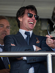 Tom Cruise enjoys a day at the races at Glorious Goodwood. Image ©Licensed to i-Images Picture Agency. 31/07/2014. Chichester, United Kingdom. Glorious Goodwood. Goodwood Racecourse. Picture by i-Images