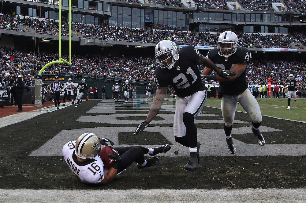 New Orleans Saints wide receiver Lance Moore (16) catches a touchdown against the Oakland Raiders during an NFL game on Sunday, Nov. 18, 2012 at the Oakland Coliseum in Oakland, Ca.  (photo by Jed Jacobsohn)