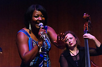 """The 12th annual Hyde Park Jazz Festival was held this weekend, Saturday, September 29th and Sunday, September 30th, 2018 at various venues around Hyde Park. Jazz musicians from all around came out to play at the two-day event. <br /> <br /> 3181, 3206, 3213, 3216, 3220, 3229, 3230 - Joan Collaso and the Larry Hicks Ensemble performed Saturday evening at the Reva and David Logan Center located at 915 E. 60th St.<br /> <br /> Please 'Like' """"Spencer Bibbs Photography"""" on Facebook.<br /> <br /> Please leave a review for Spencer Bibbs Photography on Yelp.<br /> <br /> Please check me out on Twitter under Spencer Bibbs Photography.<br /> <br /> All rights to this photo are owned by Spencer Bibbs of Spencer Bibbs Photography and may only be used in any way shape or form, whole or in part with written permission by the owner of the photo, Spencer Bibbs.<br /> <br /> For all of your photography needs, please contact Spencer Bibbs at 773-895-4744. I can also be reached in the following ways:<br /> <br /> Website – www.spbdigitalconcepts.photoshelter.com<br /> <br /> Text - Text """"Spencer Bibbs"""" to 72727<br /> <br /> Email – spencerbibbsphotography@yahoo.com<br /> <br /> #SpencerBibbsPhotography #HydePark #Community #Neighborhood<br /> #Music<br /> #HydeParkJazzFestival<br /> #Jazz<br /> #LiveMusic<br /> #JoanCollaso"""