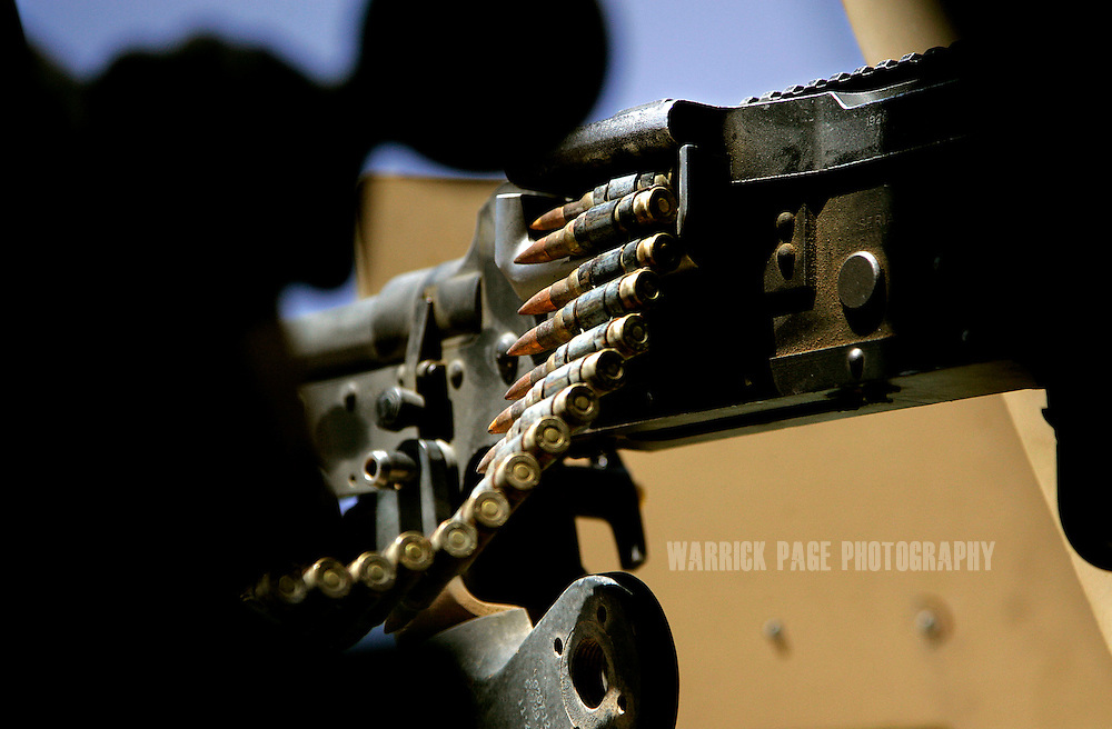 IRAQ, BASRA - JULY 5: A string of bullets hang from a mounted machine gun atop a Humvee, July 5, 2008 in Basra, Iraq.  When British forces withdrew in 2007, Basra deteriorated into street battles between numerous Shiite militias and criminal gangs. In April 2008, Iraqi prime minister, Nouri al Maliki, sent two Iraqi army divisions to retake control of Basra. While the fighting has ended, unemployment is rife, at about 70 per cent. Since early 2008, Iraq's security situation has improved with oil production increasing, record government surplus and easing sectarian tensions. (Photo by Warrick Page)