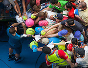 Andy Murray (GBR) signs autographs after he faced F. Lopez (ESP) in Day 6 Men's Singles play at the 2014 Australian open in Melbourne's HiSense Arena. Murray won the match 7 (7) - 6 (2), 6-4, 6-2.
