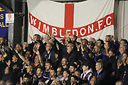 AFC Wimbledon fans during the EFL Sky Bet League 1 match between AFC Wimbledon and Milton Keynes Dons at the Cherry Red Records Stadium, Kingston, England on 22 September 2017. Photo by Matthew Redman.