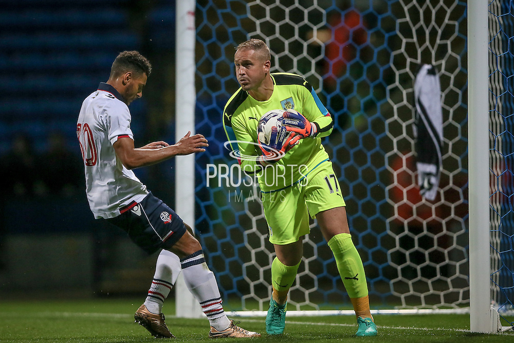 Paul Robinson (Burnley) collects the ball before Kaiyne Woolery (Bolton Wanderers) can get to it during the Pre-Season Friendly match between Bolton Wanderers and Burnley at the Macron Stadium, Bolton, England on 26 July 2016. Photo by Mark P Doherty.