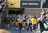 September 22 2012: The Iowa Hawkeyes walk out of the tunnel onto the field before the start of the NCAA football game between the Central Michigan Chippewas and the Iowa Hawkeyes at Kinnick Stadium in Iowa City, Iowa on Saturday September 22, 2012. Central Michigan defeated Iowa 32-31.