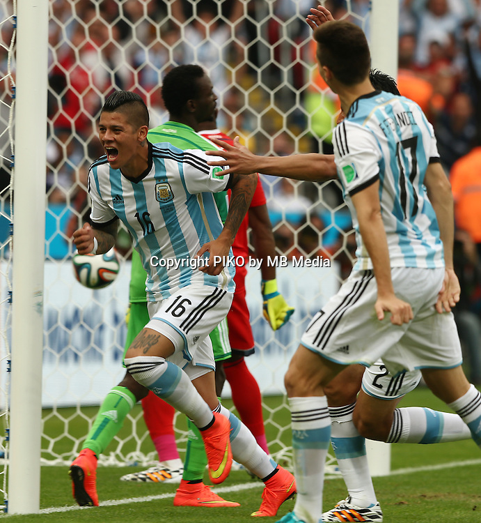 Fifa Soccer World Cup - Brazil 2014 - <br /> NIGERIA  (NGA) Vs. ARGENTINA (ARG) - Group F - Estadio Beira-RioPorto Alegre - Brazil (BRA) - June 25, 2014 <br /> Here Argentine player Marcos Rojo celebrating his goal. Scoring the goal for the 3-2.<br /> &copy; PikoPress