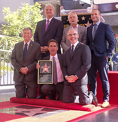 September 13, 2018 - Los Angeles, California, U.S - (L-R, front row) Hollywood Chamber of Commerce, President/CEO Leron Gubler, Eric McCormack, LA Councilmember Mitch O'Farrell, (L-R, back row) Jeff Zarrinnam,Michael Douglas and Max Mutchnick attend McCormack's star ceremony on the Hollywood Walk of Fame Star where she was the recipient of the 2,644th star on the Hollywood Walk of Fame in the category of Television on September 13, 2018 in Los Angeles. (Credit Image: © Ringo Chiu/ZUMA Wire)