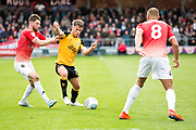 Cambridge United midfielder Luke Hannant tackled by the opponent during the EFL Sky Bet League 2 match between Salford City and Cambridge United at Moor Lane, Salford, United Kingdom on 12 October 2019.