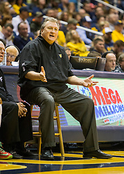 Dec 5, 2015; Morgantown, WV, USA; West Virginia Mountaineers head coach Bob Huggins talks with a player during the second half against the Kennesaw State Owls at WVU Coliseum. Mandatory Credit: Ben Queen-USA TODAY Sports