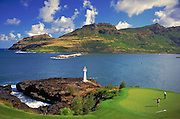 Golfer missing putt, Kauai Hawaii, golf, Ocean,  water, pond, green, flag, flagstick, golf hole, activity, Kauai Lagoons - Kiele, Golf Course, Hawaii