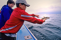 Brett, 10, catches a Cod off the coast of Prince Edward Island, and throws it back due to small size.