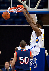 November 30, 2009; San Jose, CA, USA;  San Jose State Spartans center Chris Oakes (30) dunks in front of Saint Mary's Gaels center Omar Samhan (50) during the first half at the Event Center Arena.  Saint Mary's defeated San Jose State 78-71.