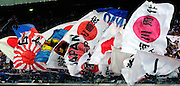 Japan national soccer team supporters wave a variety of flags during their team's friendly match against Scotland in Yokohama, Japan on Saturday 10 Oct. 2009. Japan won 2-0..Photographer: Robert Gilhooly
