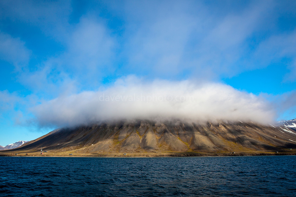 "A cloud caps a mountain on the Isjforden, Svalbard This mage can be licensed via Millennium Images. Contact me for more details, or email mail@milim.com For prints, contact me, or click ""add to cart"" to some standard print options."