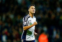 Jason Davidson of West Brom celebrates after scoring in the penalty shootout to secure a win for his side - Photo mandatory by-line: Rogan Thomson/JMP - 07966 386802 - 26/08/2014 - SPORT - FOOTBALL - The Hawthorns, West Bromwich - West Bromwich Albion v Oxford United - Capital One Cup Round 2.