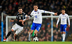 Lorenzo Pellegrini of Italy takes on Lucas Biglia of Argentina - Mandatory by-line: Matt McNulty/JMP - 23/03/2018 - FOOTBALL - Etihad Stadium - Manchester, England - Argentina v Italy - International Friendly