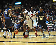 """Ole Miss' Reginald Buckner (23) vs.East Tennessee State's Kinard Gadsden-Gilliard (35), East Tennessee State's Lester Wilson (15), and East Tennessee State's Hunter Harris (20) at the C.M. """"Tad"""" Smith Coliseum in Oxford, Miss. on Saturday, December 14, 2012. Mississippi won 77-55 to improve to 7-1. (AP Photo/Oxford Eagle, Bruce Newman).."""