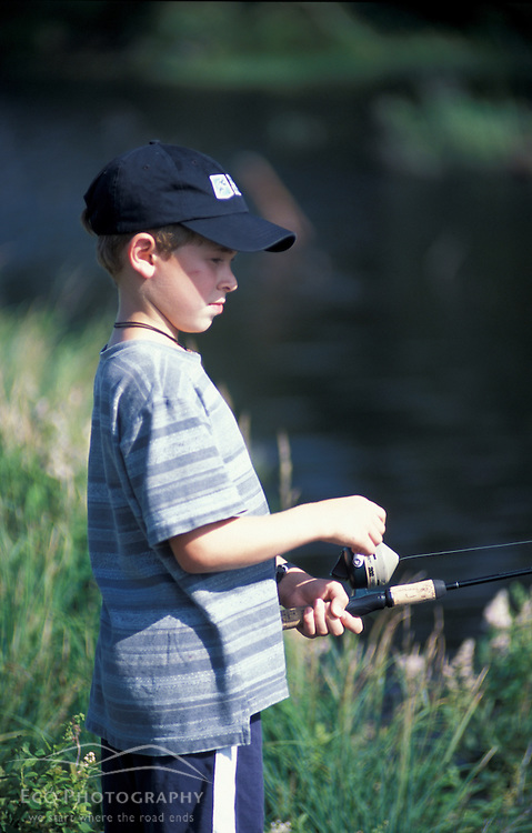 Randolph, NH.A young boy tries his luck at fishing on a beaver pond in New Hampshire's White Mountains.