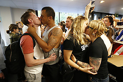 © Licensed to London News Pictures. 13/08/2016. London, UK. Gay couples stage a big kiss in protest at Sainsbury's in Hackney, east London on Saturday, 13 August 2016 Protest goes as a reaction to a security guard in Sainsbury's on Hackney Road allegedly told a shopper that holding hands with his boyfriend was 'inappropriate' on Monday. Photo credit: Tolga Akmen/LNP