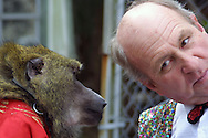 Circus legend Ward Hall seems to be sharing a secret with one of his baboons near his home in Gibsonton, Florida.  Gibsonton is a long-time home for many in the circus industry.