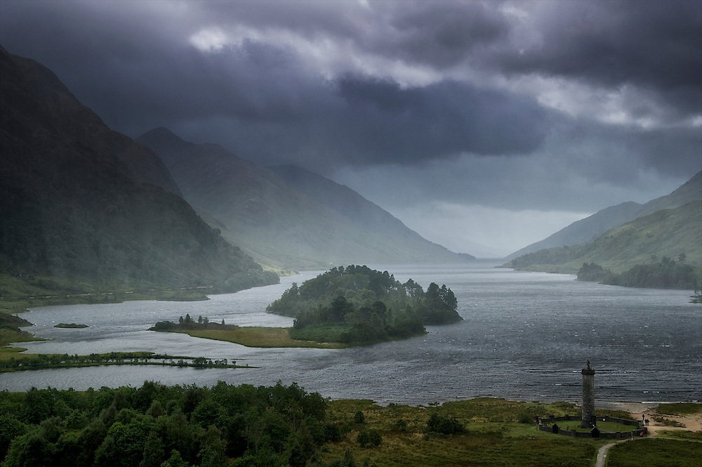 Looking over the statue to the Highlanders at Glenfinnan as rains sweep down Loch Shiel in the Highlands.  It is here that Bonnie Prince Charlie rallied the Highlanders to his cause (and sent them to their eventual doom at Culloden Moor.)