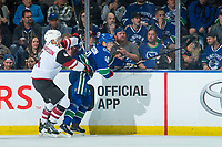 KELOWNA, BC - SEPTEMBER 29:  Niklas Hjalmarsson #4 of the Arizona Coyotes back checks Elias Pettersson #40 of the Vancouver Canucks during first period at Prospera Place on September 29, 2018 in Kelowna, Canada. (Photo by Marissa Baecker/NHLI via Getty Images)  *** Local Caption *** Elias Pettersson;Niklas Hjalmarsson