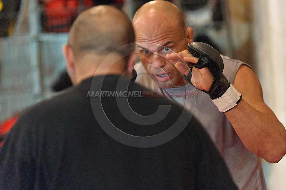 Randy Couture (facing) and Gil Martinez do some boxing pad work during a pre-fight training session at Straight Blast Gym ahead of UFC 105 in Manchester, England on November 12, 2009.