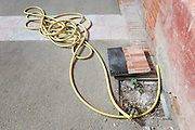 coiled garden hose on pavement