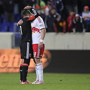 Kenny Cooper, Red Bulls, is consoled by Marcelo Saragosa, D.C United after the final whistle. Cooper missed a retaken penalty during his sides loss during the New York Red Bulls V D.C. United Major League Soccer, Eastern Conference Semi Final 2nd Leg match at Red Bull Arena, Harrison. New Jersey. USA. 8th November 2012. Photo Tim Clayton