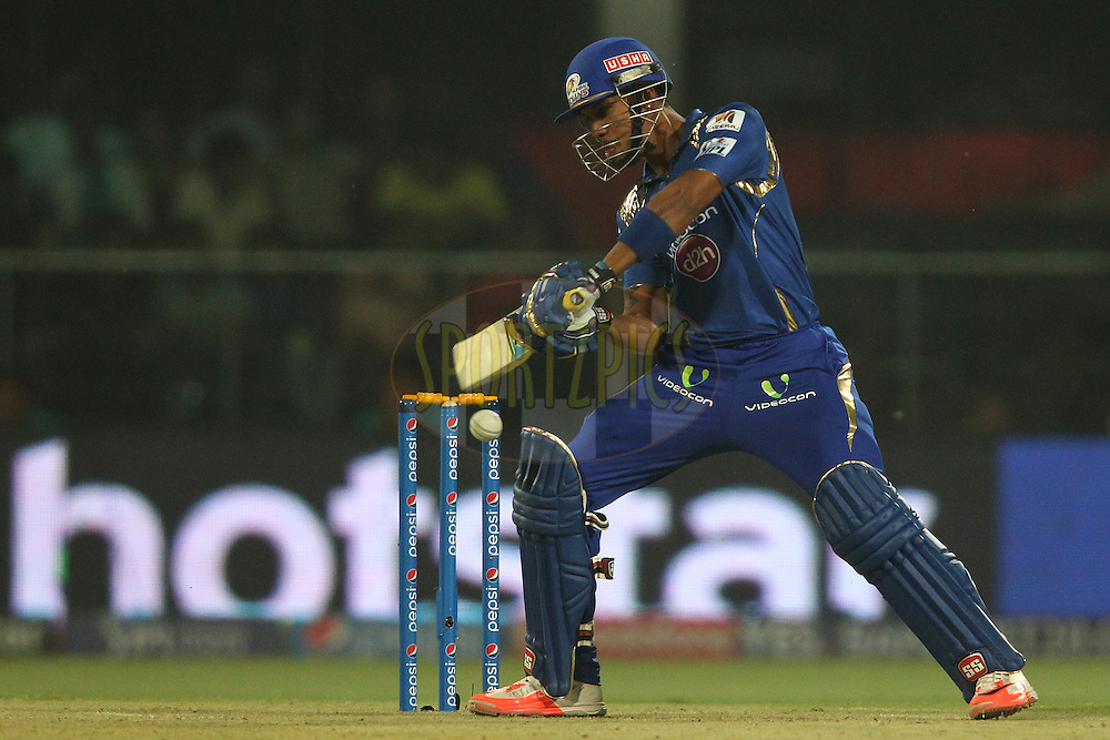 Lendl Simmons of Mumbai Indians square cuts a delivery to the boundary during match 21 of the Pepsi IPL 2015 (Indian Premier League) between The Delhi Daredevils and The Mumbai Indians held at the Ferozeshah Kotla stadium in Delhi, India on the 23rd April 2015.<br /> <br /> Photo by:  Shaun Roy / SPORTZPICS / IPL