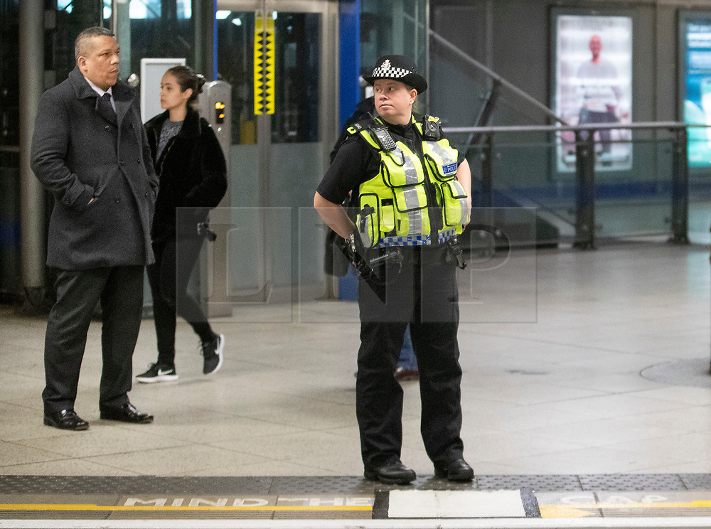 © Licensed to London News Pictures. 17/04/2019. London, UK. A police officer guards a platform at Westminster underground station after XR (Extinction Rebellion) climate change protest group threatened to continue their demonstrations and blockades on the tube network. XR actions are still blocking traffic at various location across the capital despite nearly 300 arrests and are expected to disrupt underground travel today. Photo credit: Peter Macdiarmid/LNP