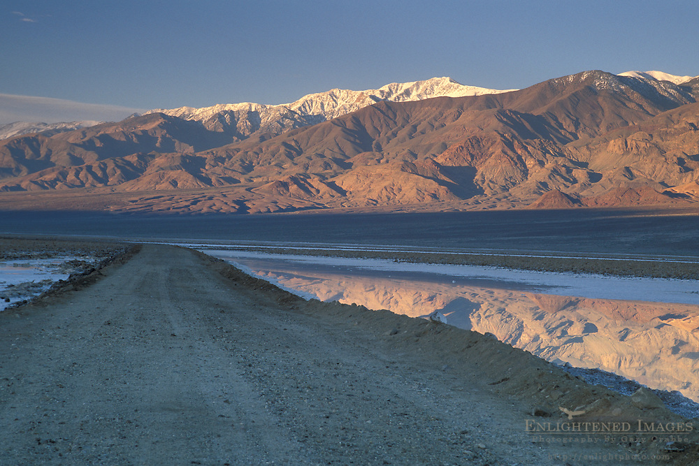 Sunrise light on Panamint Mountains over West Side Road, Devils Golf Course, Middle Basin, Death Valley, California