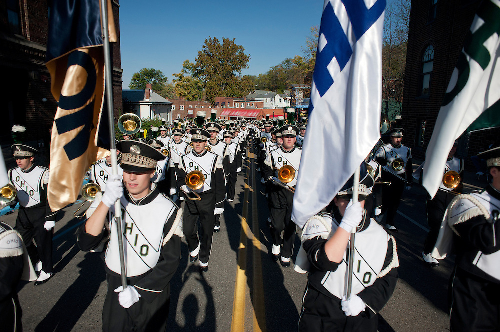The OU marching band makes its way up Union street during the homecoming parade. Photo by: Ross Brinkerhoff..